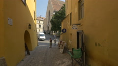 Museum Square seen from a narrow street in Sighisoara Stock Footage