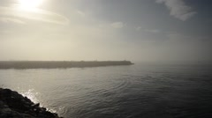 Sun over pier shrouded in fog and mist in autumn video Stock Footage