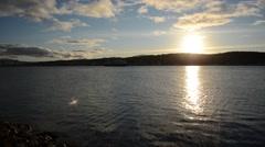 The ship hurtigruten leaving tromsoe city harbour in autumn sunshine on blue sea Stock Footage