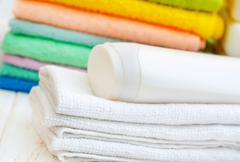 towels and shampoo - stock photo