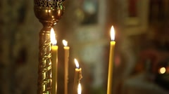 Many candles burning in church Stock Footage