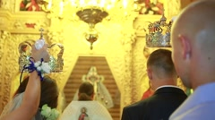In church holding crowns over the heads of the bride Stock Footage