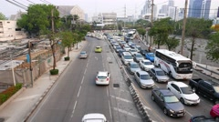 Bottleneck on city driveway seen from above crowded street, empty outgoing lanes - stock footage