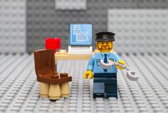 Lego policeman going to arrest - stock photo