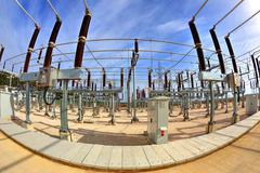 High voltage switchyard in fisheye perspective - stock photo