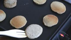 Cooking  pancakes on electric barbecue Stock Footage
