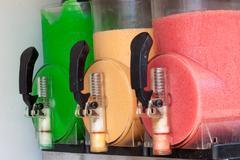 The machine gun doing the different frozen drinks - stock photo