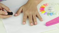 Painting gel polish of pink color on female nails Stock Footage