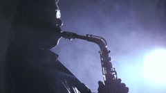 African man colored old black playing saxophone dark background music backlit - stock footage