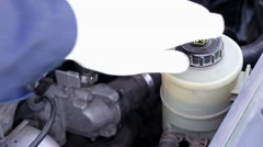 Checking antifreeze in car at the  station Stock Footage