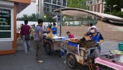 Street food and fresh juice vendor carts at sidewalk, POV camera walk aside Stock Footage
