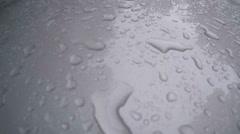 Rain on freshly waxed truck hood Stock Footage