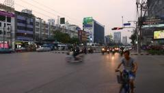 Modern Asian city junction in dusk loudly motorcycle traffic move on green light Stock Footage