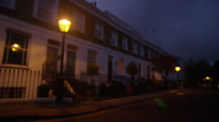 4K Night time view of a row of terraced town houses in a wealthy London suburb - stock footage