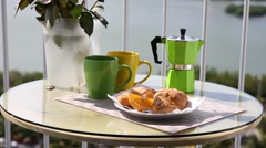Romantic breakfast with fresh croissants and slice of orange fruit Stock Footage