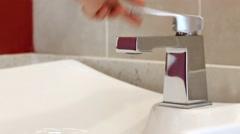 Open faucet in bathroom Stock Footage