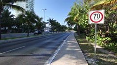 Seventy kilometers per hour speed limit sign on caribbean street road Stock Footage