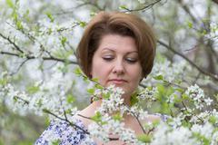 Woman with allergic rhinitis in  spring garden Stock Photos