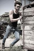 Handsome man model dressed punk, hipster posing dramatic in grun Stock Photos