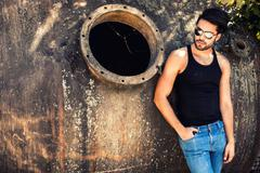 handsome man model dressed punk, hipster posing dramatic in grun - stock photo
