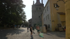 Selling souvenirs in Museum Square, Sighisoara Stock Footage
