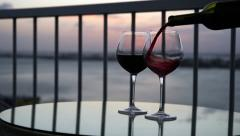 Pouring red wine in to glasses Stock Footage