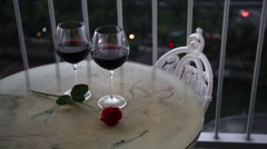 Romantic evening with red wine on balcony Stock Footage