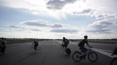 People on bicycles at Berlin Tempelhof Airport park Stock Footage