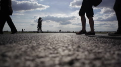Silhouettes of people on abandoned road runway at Berlin Tempelhof Airport Stock Footage
