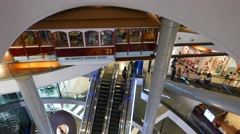 Restaurant decorated with railway carriage, within shopping complex, escalators Stock Footage
