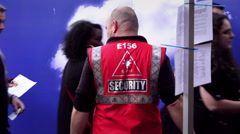 Stock Video Footage of Security staff monitoring audience before entering a concert show