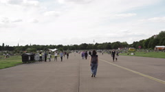 People on abandoned runway at Berlin Tempelhof Airport park - stock footage