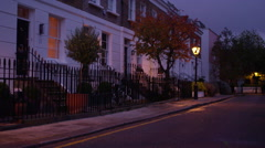 4K Night time view of a row of terraced town houses in a wealthy London suburb Stock Footage