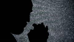 Silhouette man praying static tv noise - stock footage