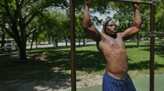 Fit African ethnicity man completing chin ups - stock footage