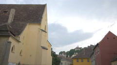The Monastery Church and the old buildings in Sighisoara - stock footage