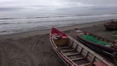 flight over fishing boats on an ocean coast - stock footage