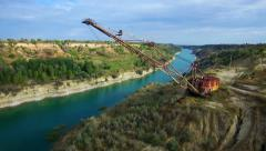Aerial: giant mining excavator in a quarry Stock Footage