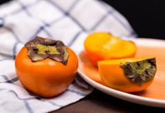two persimmons - stock photo