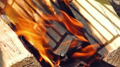 burning wood under the grill - stock footage
