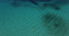 Aerial shot of woman in turquoise sea waters Stock Footage