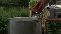 Home made tomato pasta sauce-dumping in celery in pot- close up Stock Footage
