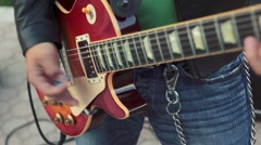 Cool shot of Guitar player's hands playing electric guitar - stock footage