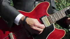 Cool shot of guitarist playing a classic electric guitar. - stock footage