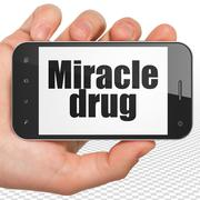 Medicine concept: Hand Holding Smartphone with Miracle Drug on display - stock illustration