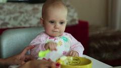 Beatiful girl feeds her baby - stock footage