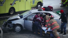 Car Accident during the winter at an intersection Stock Footage