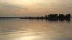 Sun over island on a lake Stock Footage