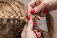 Stock Photo of braided pigtails in the beauty salon