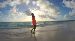 Young African American girl enjoying vacation on tropical beach Stock Footage